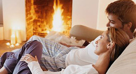 Couple By Fireplace