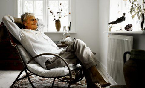 elderly-man-near-radiator